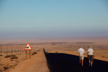 Road leading out into the Namib Desert in Namibia. by Ian Yates