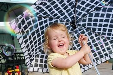 "Enjoying Grannies garden with a ""hairbrella"" by Jason Timms"