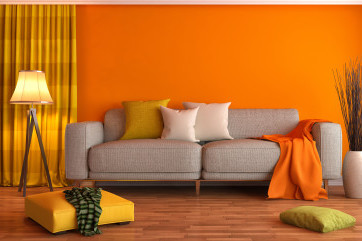 Orange lounge with grey sofa