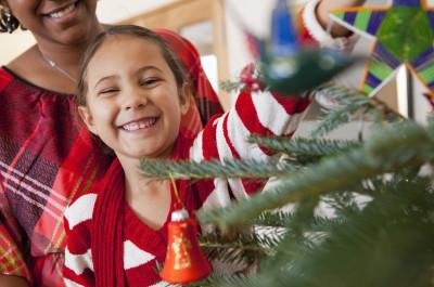 Girl decorating tree