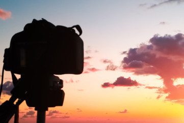 Camera in front of a sunset view