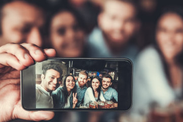 Group selfie in a bar.