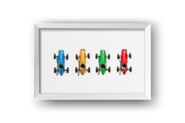 colourful toy cars framed in a box frame